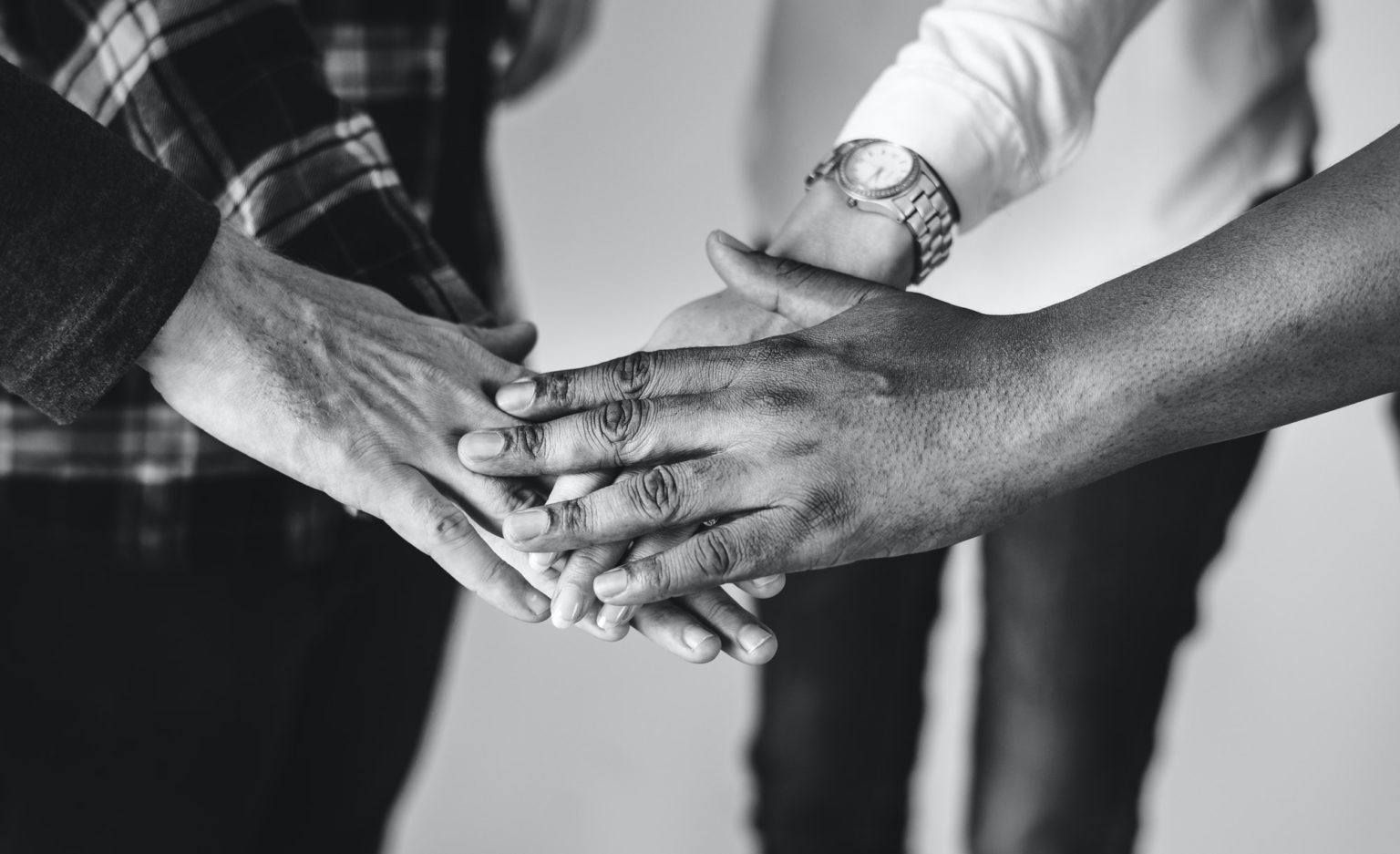 Diverse people joining hands together teamwork and community concept