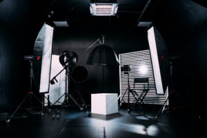 Modern photo studio with professional equipment. Black cyclorama.